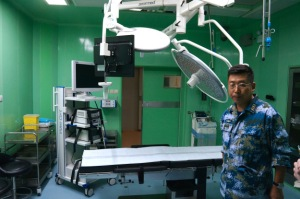 "Senior Captain Sun Demonstrates an Operating Room in PLAN Hospital Ship ""Peace Ark"" (Source: USNI News)"